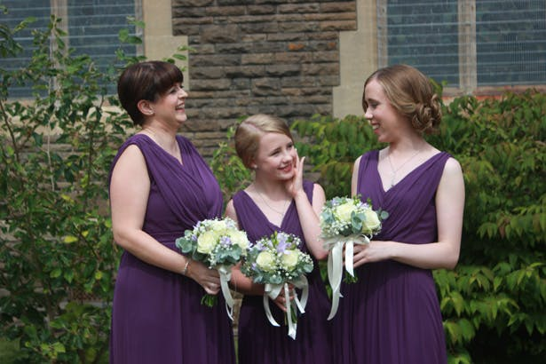 Bridesmaids in purple Grecian styled dress | Purple themed wedding| Rhiannon & Michael's Real Wedding | Confetti.co.uk