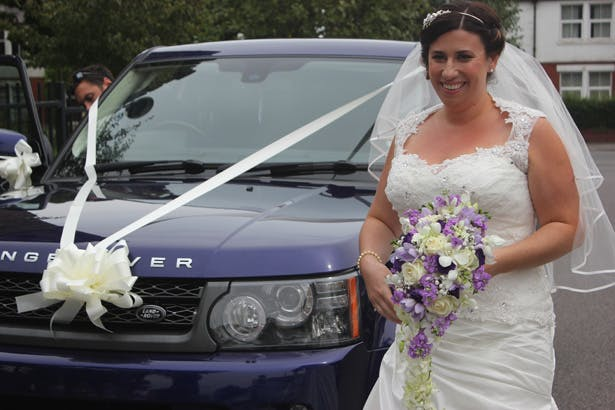 Bride arriving at the ceremony in a wedding Range Rover | Purple themed wedding| Rhiannon & Michael's Real Wedding | Confetti.co.uk