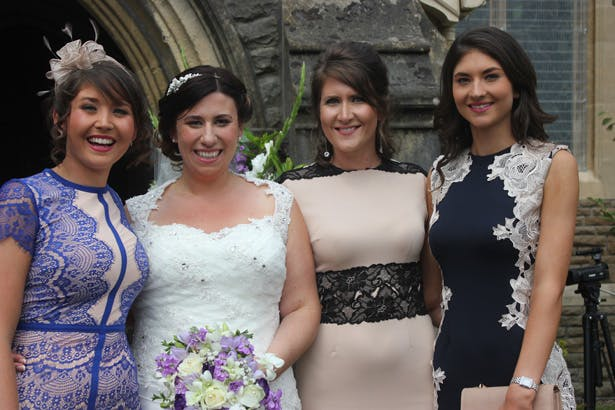 Bride with her female wedding guests | Purple themed wedding| Rhiannon & Michael's Real Wedding | Confetti.co.uk