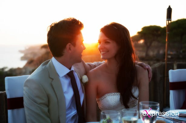 Bride and groom enjoying their wedding reception at sunset | Sheraton Algarve Hotel, in the Algarve, Portugal| Debora and James's real destination wedding | Confetti.co.uk