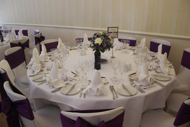Wedding reception at De Courcey's Manor, Cardiff | White and purple wedding set up | Purple themed wedding| Rhiannon & Michael's Real Wedding | Confetti.co.uk