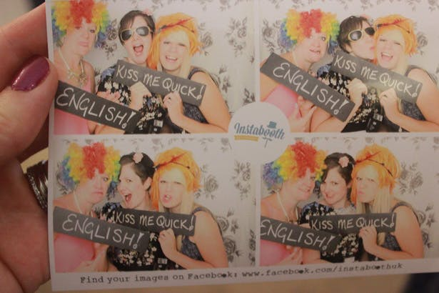 Wedding entertainment ideas |Picture of guests using props for the photobooth | Purple themed wedding| Rhiannon & Michael's Real Wedding | Confetti.co.uk
