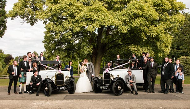 The bride and groom with their bridal party by Momentous Photography Ltd | Shasha and James real wedding | 1920's Great Gatsby Wedding Confetti.co.uk