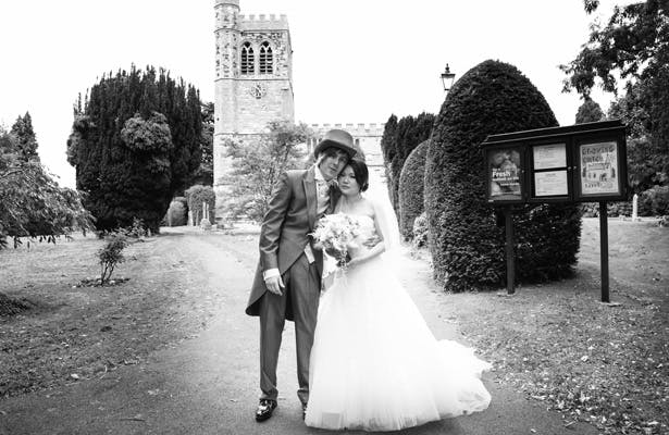 The newlyweds outside the church |Wedding ceremony at St Marys Church, Bletchley | Shasha and James real wedding | 1920's Great Gatsby Wedding Confetti.co.uk