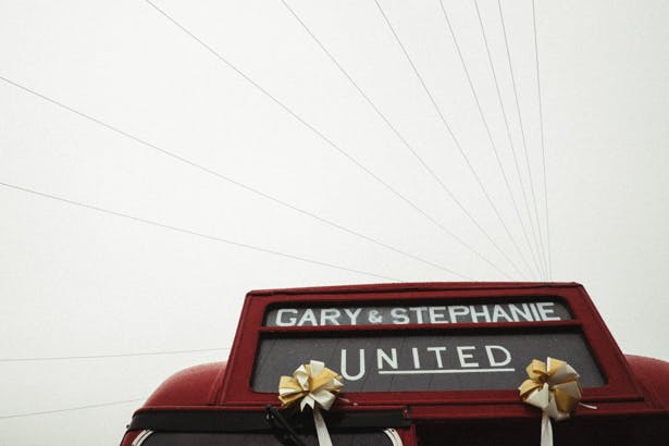 Personalised wedding message on the vintage red London bus | Fun wedding ideas | Steph and Gary's Real Garden Wedding | Confetti.co.uk