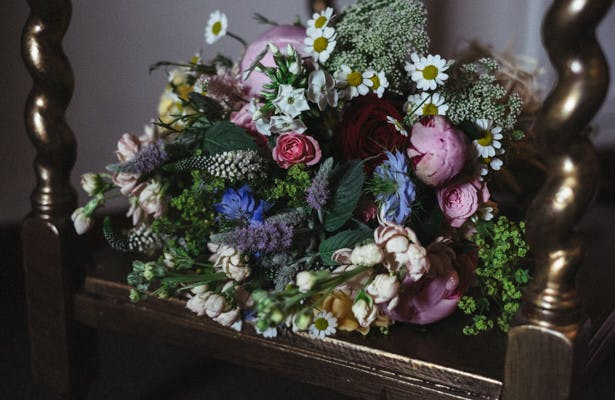 Wilde flowers and rose bridal bouquet | Rustic themed wedding flower ideas| Steph and Gary's Real Garden Wedding | Confetti.co.uk