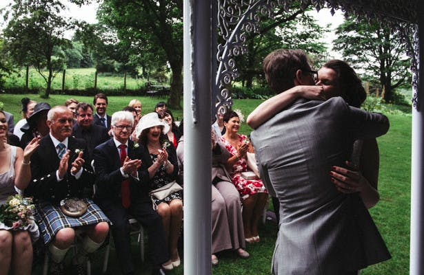 The bride and grooms first kiss as husband and wife | Garden wedding ideas | Steph and Gary's Real Garden Wedding | Confetti.co.uk