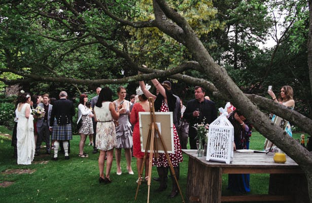 Wedding guests enjoying refreshments in the garden| Garden wedding ideas | Steph and Gary's Real Garden Wedding | Confetti.co.uk