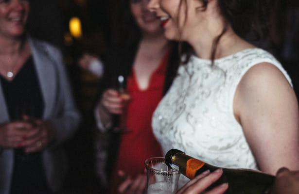 Bride and guests enjoying champagne during the cocktail hour| Steph and Gary's Real Garden Wedding | Confetti.co.uk
