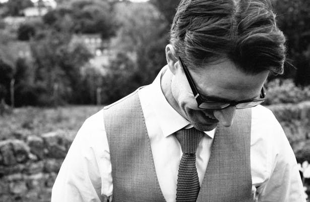 Groom in a grey waist coat and red tie | Steph and Gary's Real Garden Wedding | Confetti.co.uk
