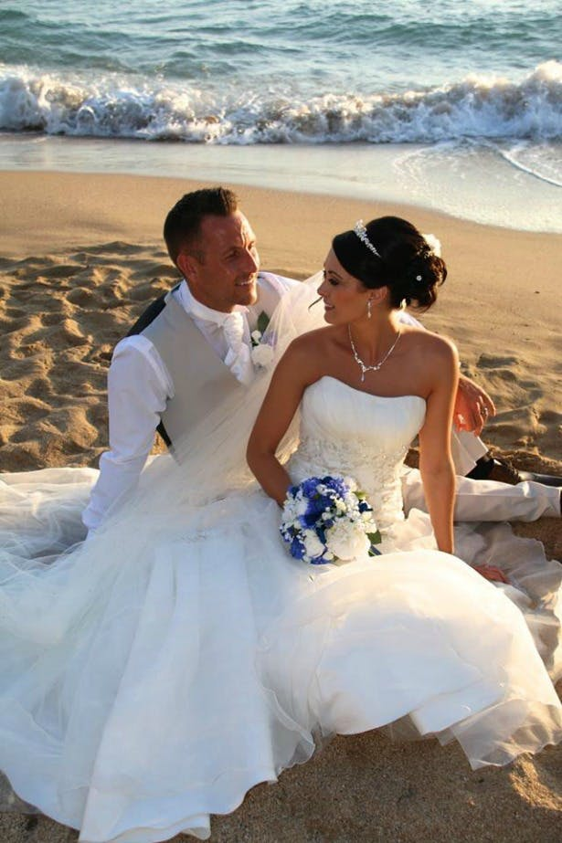 Michelle's wedding abroad with bouquet by Silk Blooms