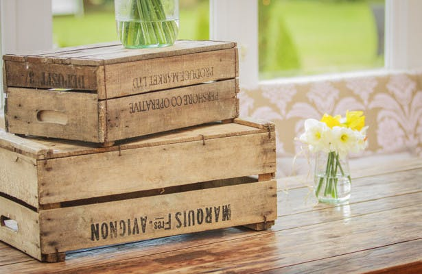 Vintage apple crates and spring flowers wedding decor | Spring wedding theme ideas | Wedding at the Deer Park country house | Nadine and Roberts Real Wedding | Confetti.co.uk