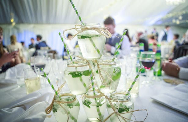 Tower of mason jars with mint cocktails | Spring wedding theme ideas | Wedding at the Deer Park country house | Nadine and Roberts Real Wedding | Confetti.co.uk