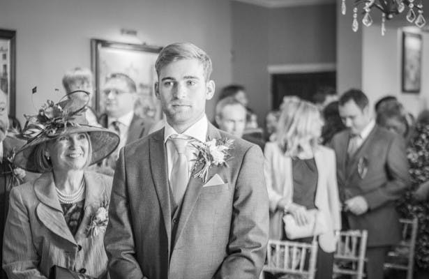 Groom waiting for his bride | Wedding ceremony at the Deer Park country house  | Nadine and Roberts Real Wedding | Confetti.co.uk