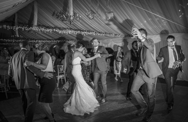 Bride and groom dancing with their wedding guests| Nadine and Roberts Real Wedding | Confetti.co.uk