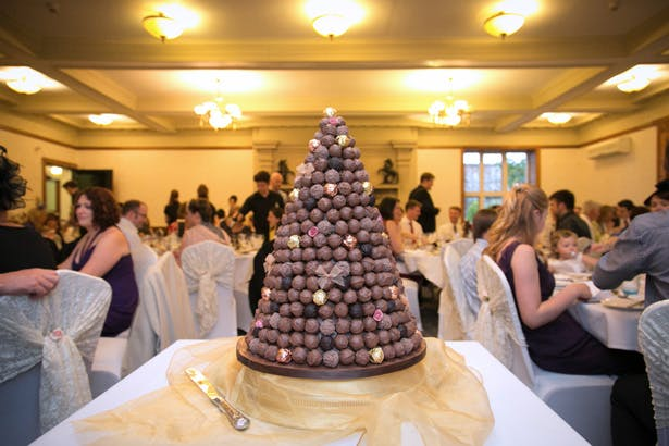 Chocolate truffle wedding cake | Lizzie and Greg's Real Wedding | Confetti.co.uk