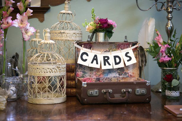 Vintage table decor ideas | Vintage suitcase for wedding cards | Vintage ideas | Lizzie and Greg's Real Wedding | Confetti.co.uk