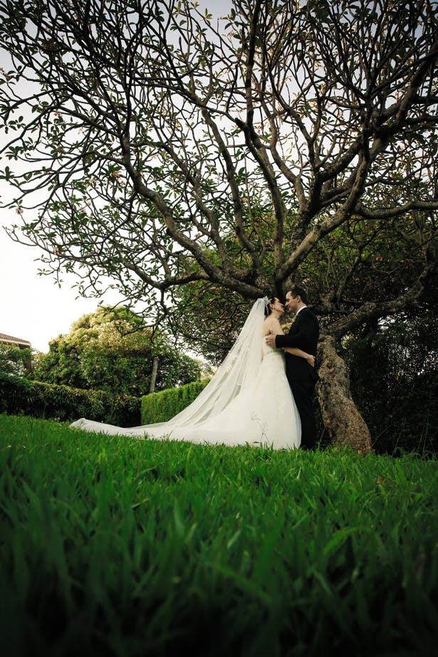 The bride and groom in the garden by Juliana Mozart  Claudia and Felipe's Intiamte Wedding   Confetti.co.uk