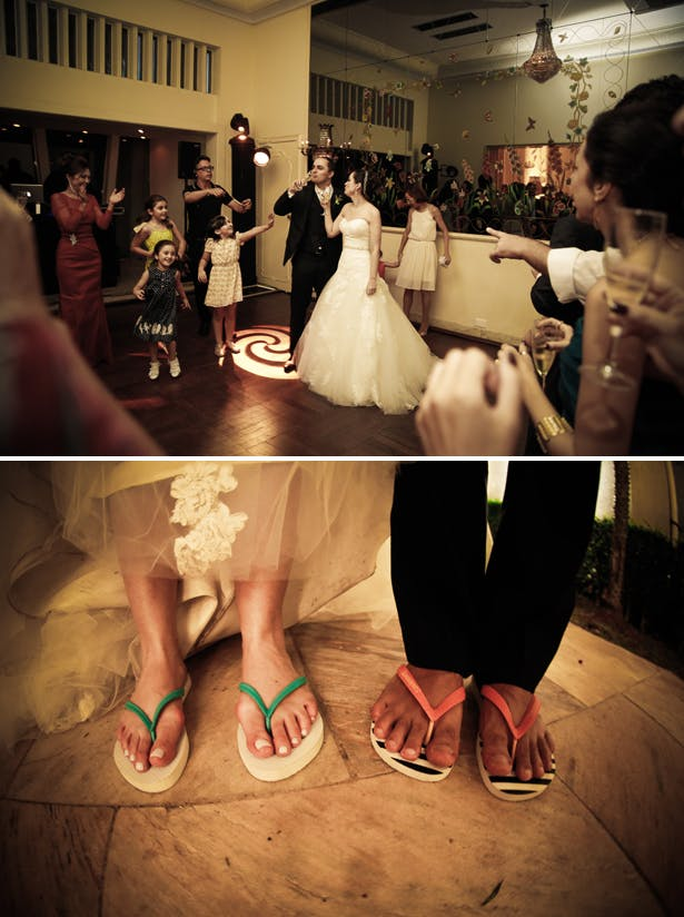 The bride and groom toasting their marriage   The newlyweds wearing flip flops  Claudia and Felipe's Intiamte Wedding   Confetti.co.uk