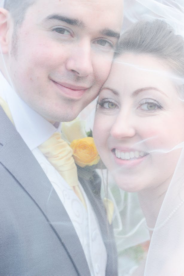 The bride and groom by Lawless Rose Photography | Lynn and Mark's Grey and Yellow wedding | Confetti.co.uk