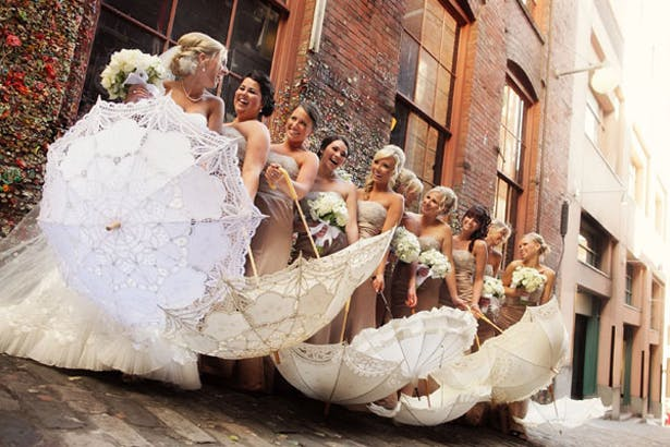 Bridesmaids Posing with Parasols | Confetti.co.uk