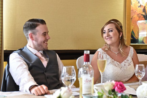 Laura & Daniel at their wedding breakfast; styling and decor from Confetti.co.uk