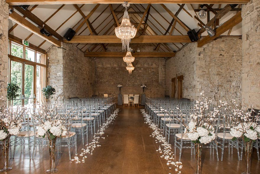 Flower Petal Lined Wedding Aisle at The Monks' Refectory at Notley Abbey Wedding Venue in Buckinghamshire - Bijou Wedding Venues - Beautiful Wedding Aisle Inspiration | Confetti.co.uk