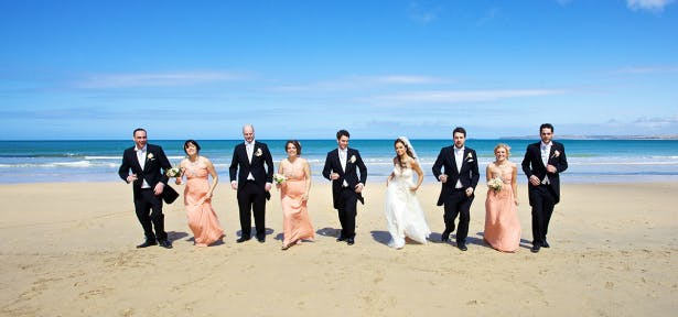 Wedding party on the exclusive Blue Flag beach at Carbis Bay Hotel & Estate.