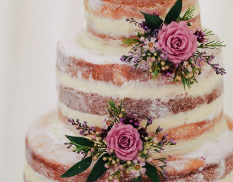Semi Naked Wedding Cake with Beautiful Flowers and Roses | Confetti.co.uk