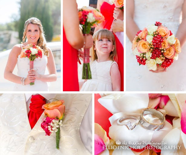 The bride and her bridesmaids. The bride has a coral, cream and red bouquet with roses and rose buds.