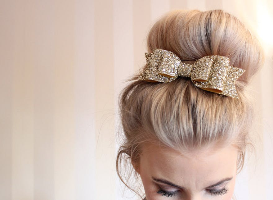 Large Oversized Gold Glitter Fabric Hair Bow Hair Clip by LovelyLittlesandCo on Etsy | Confetti.co.uk
