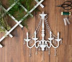 DIY Rustic Glam Chandelier and Fern Overhang Thumbnail | Confetti.co.uk