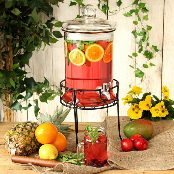 Round drink dispenser with stand