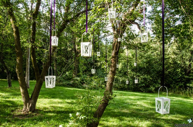 Lanterns Hanging From Trees | Confetti.co.uk