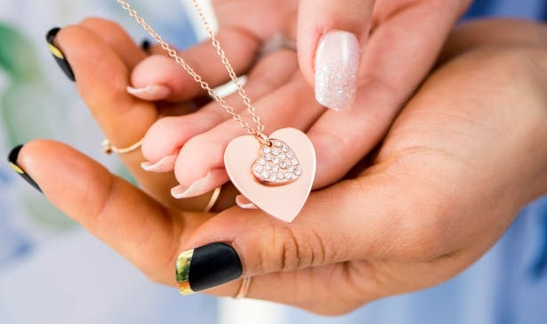 A rose gold, double heart necklace that combines modern and traditional elements by Confetti.co.uk