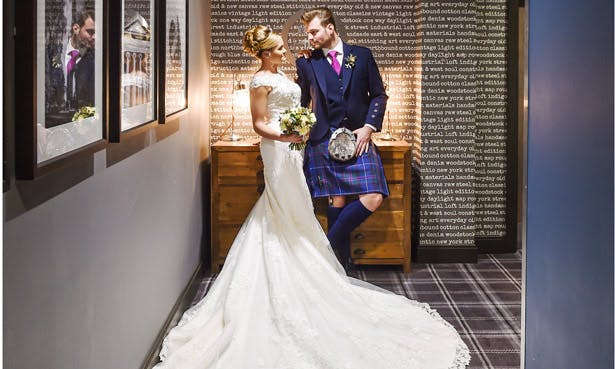 Bride and Groom share a loving look at The Village Hotel Edinburgh | Confetti.co.uk