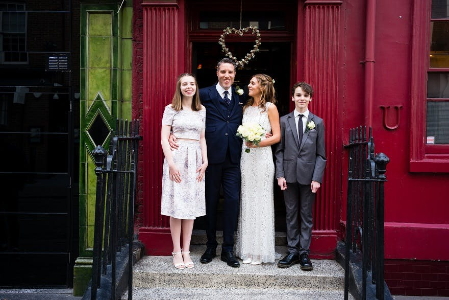 Bride & Groom with their children outside Soho city wedding venue | Confetti.co.uk
