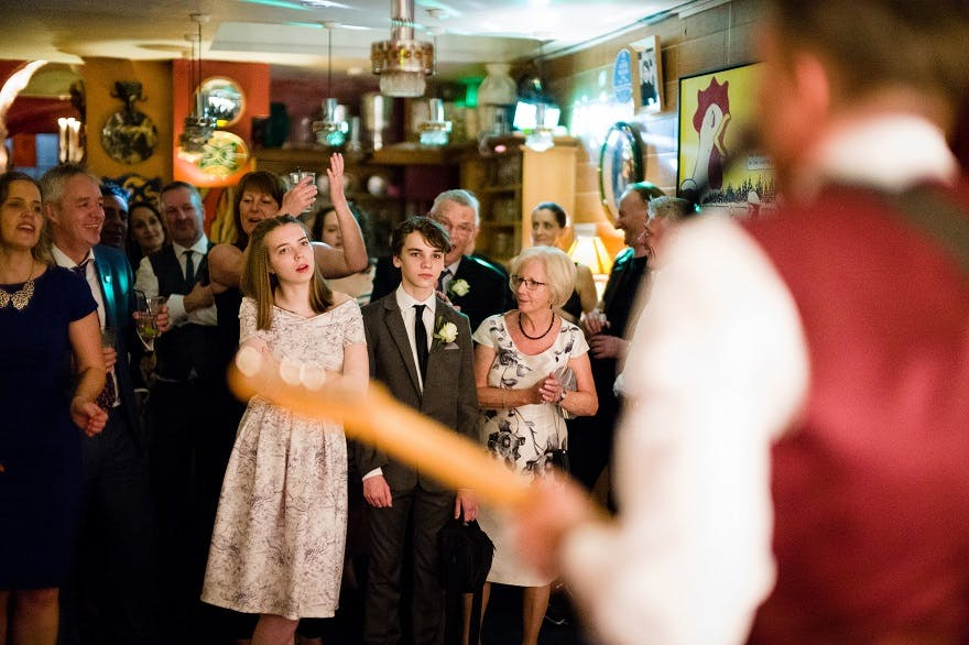 Groom playing guitar at soho city wedding | Confetti.co.uk
