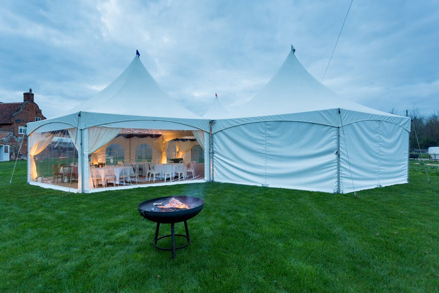 Outdoor Wedding Marquee with Fire Pit | Confetti.co.uk