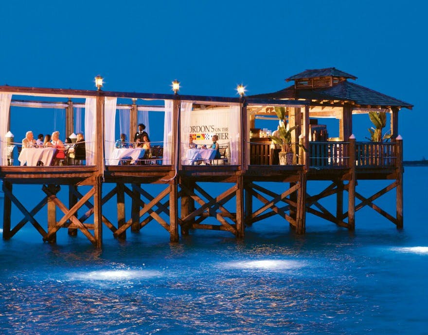 Sandals Royal Bahamian Bahamas pontoon at night | Confetti.co.uk