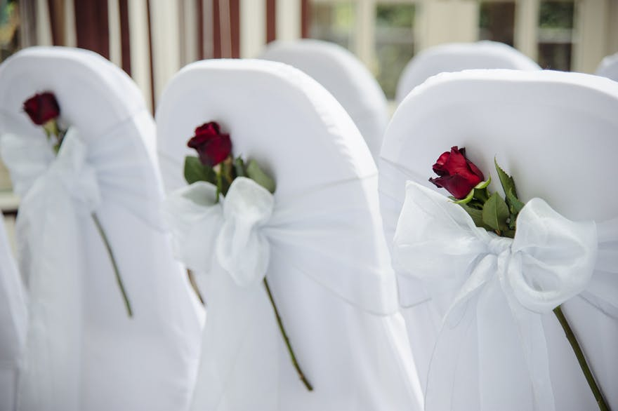 The Montague on the Gardens Romantic Red and White Wedding Ceremony Chair Decor | Confetti.co.uk