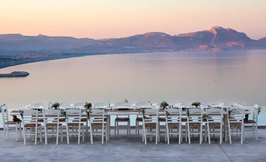 Wedding table at sunset with Greek Dream Planner | Confetti.co.uk