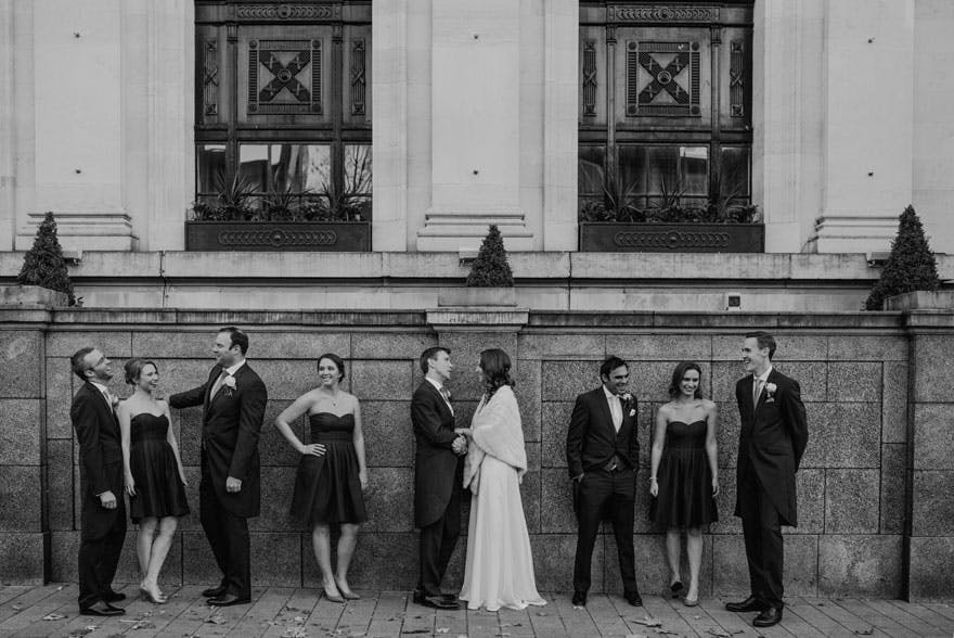 Islington Assembly Hall Exterior Shot with Bride and Groom and Wedding Party | Confetti.co.uk