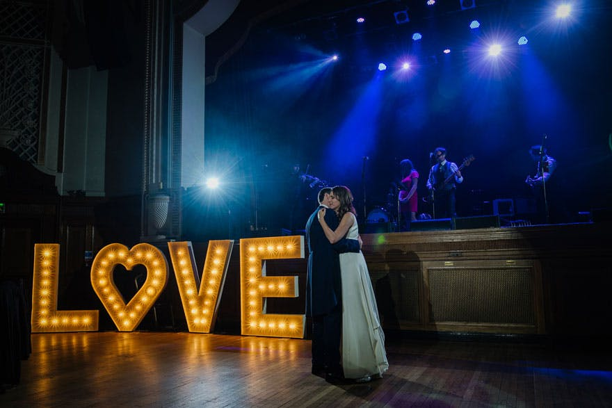Islington Assembly Hall LOVE Sign Bride and Groom First Dance with Live Wedding Band | Confetti.co.uk