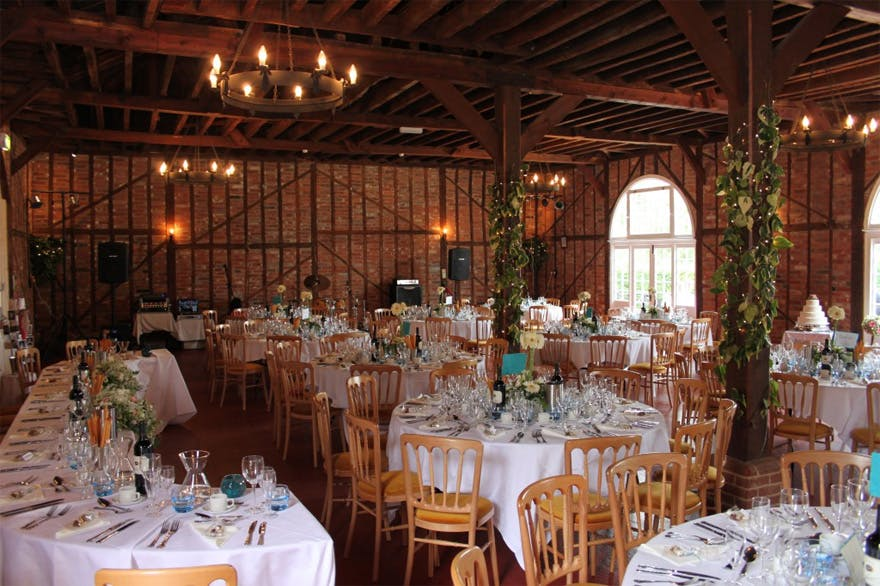 The Coach House at Marks Hall Rustic Wedding Reception Room | Confetti.co.uk