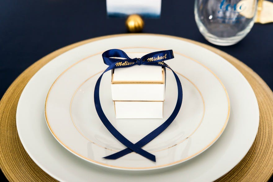 Winter wedding favour box with personalised navy and gold ribbon | Confetti.co.uk
