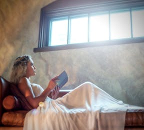 Bride Fairytale Princess Reading a Book by Light from a Window | Confetti.co.uk
