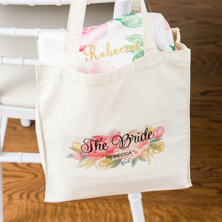 Personalised The Bride Floral Watercolour Bag with Pink Dressing Gown | Confetti.co.uk