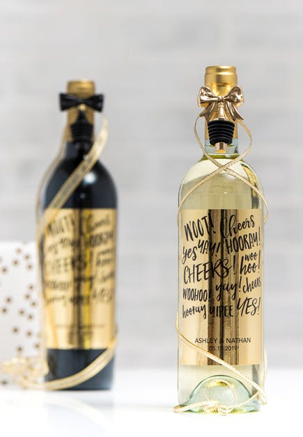 Wine Bottle with Personalised Label and Bow Bottle Stoppers | Confetti.co.uk