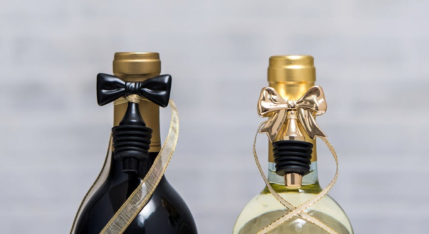 Wine Bottles with Gold Bow and Black Tie Bottle Stoppers Engagement Gift Ideas | Confetti.co.uk